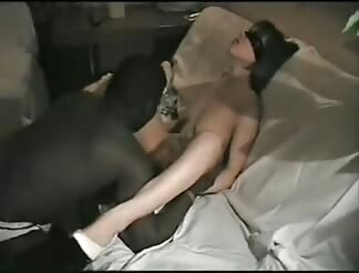 Blindfolded light brown haired slammed by two dark dicks