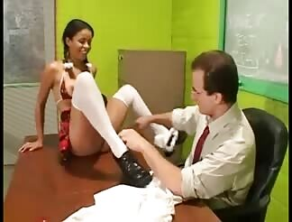 Pigtailed teen in stockings rammed on a desk