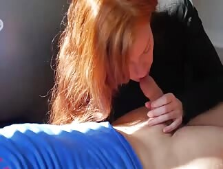Natural redhead gives a blowjob after workout session