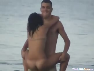 Crazy lovers screwing in the sea