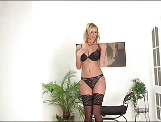 Blond with humongous tits stripping in dark lingerie