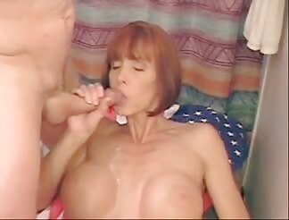 Mouthfull of cum for fake tits redhead milf