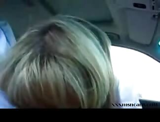 This amateur cougar blond sucks a man in a car