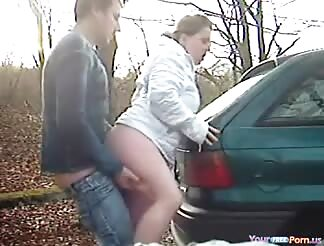 Doggyfuck creampie on the car in outdoor
