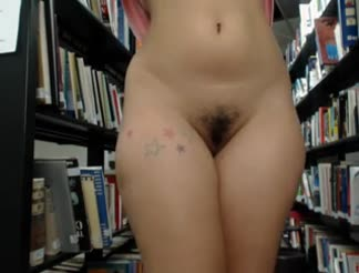 HOT chick masturbating in a library