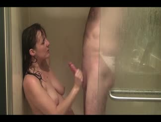 Wife sucking and rubbing dick under the shower