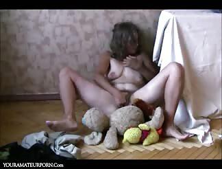 Lovely mature masturbating