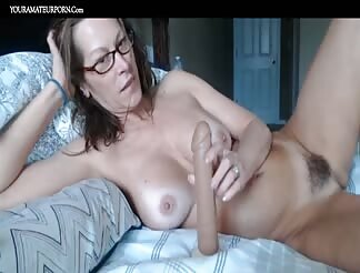 Mature with hairy pussy and big tits teasing on webcam