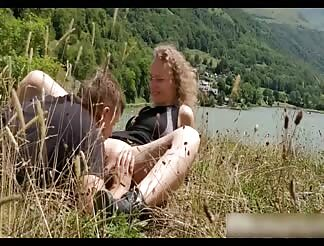 Licking her pussy to orgasm near a lake