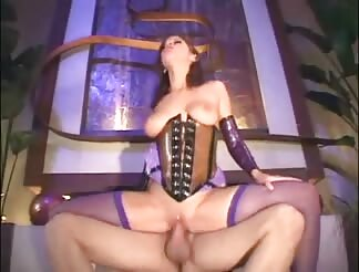 Brunette bangs in shiny latex corset and fishnets