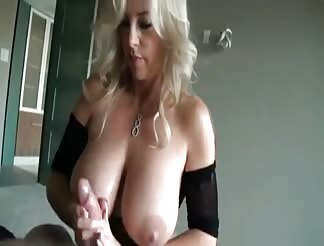 MILF with huge tits having fun