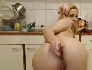 Teen toying ass in the kitchen