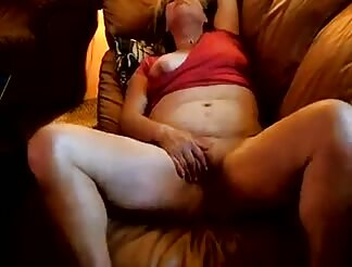 Heather masturbates on the sofa