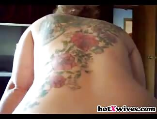 Bootylicious mom with tattoos rides on dick