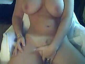 Busty chic masturbates on cam